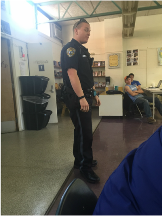 Officer Scott talks with students.
